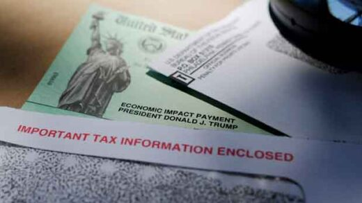 President Donald Trump's name is seen on a stimulus check