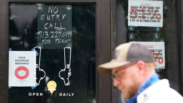 """No Entry"" sign is posted on the door of the Craft Beer Cellar"