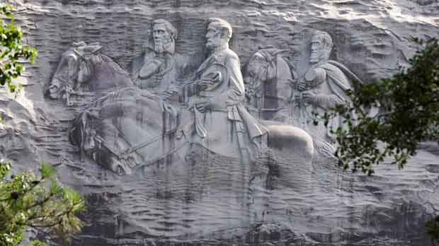carving depicting Confederate Civil War figures Stonewall Jackson, Robert E. Lee and Jefferson Davis