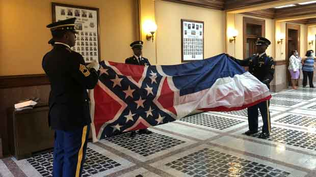 Honor guard members from the Mississippi National Guard practice folding the former Mississippi flag