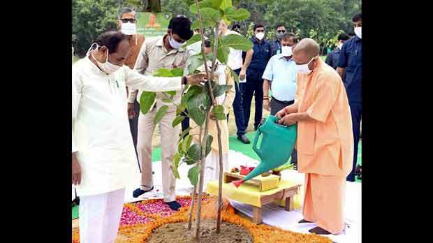 ttar Pradesh Chief Minister, Yogi Adityanath, right, inaugurates a day long tree planting campaign