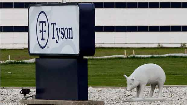 a sign sits in front of the Tyson Foods plant in Waterloo, Iowa