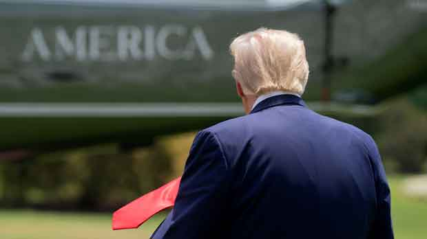 President Donald Trump walks on the South Lawn of the White House