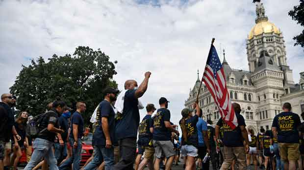 """People participating in a """"Back the Blue"""" rally"""