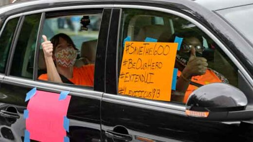 motorists take part in a caravan protest