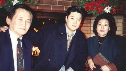 Man poses with his parents