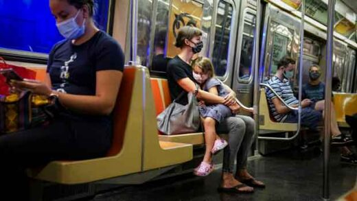 a child rests on a subway car