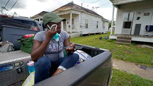 Woman reacts to her damaged home after hurricane
