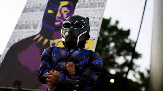 Child poses as Black Panther