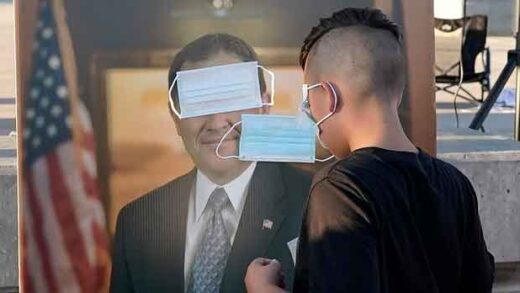 "children play ""pin the mask on Gov. Gary Herbert"""