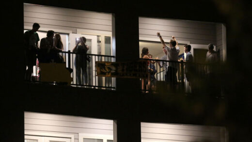 partiers congregate on the balcony