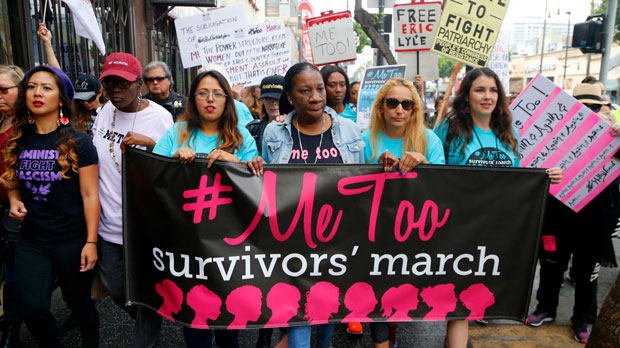 Tarana Burke, founder and leader of the #MeToo movement, marches with others