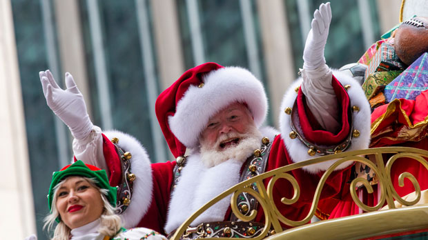 Santa Claus waves during the Macy's Thanksgiving Day Parade