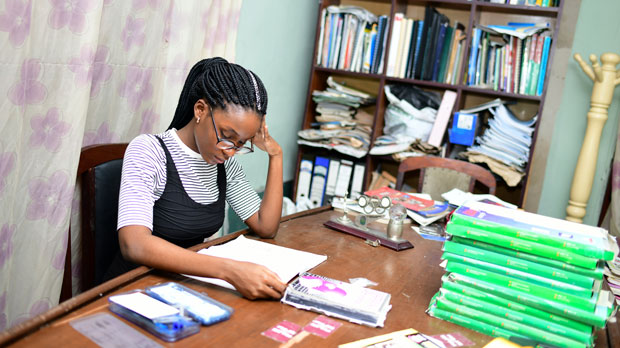 16 year old study at the family library in Calabar, Nigeria