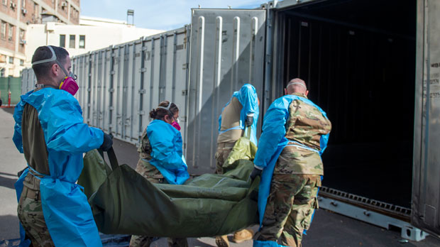 National Guard members assisting with processing COVID-19 deaths, placing them into temporary storage