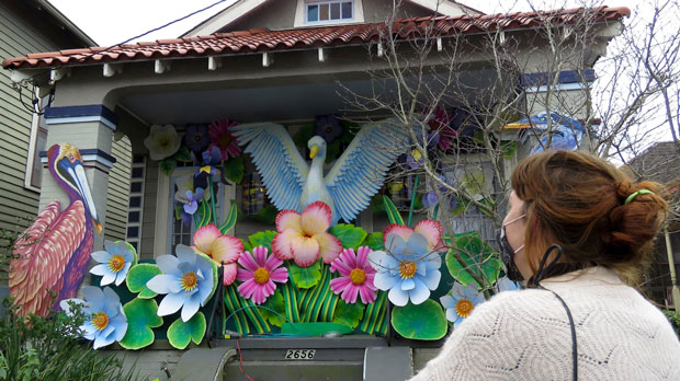 Woman looks at decorated house