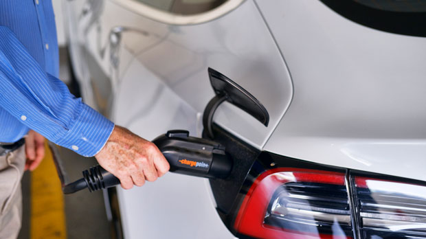 driver plugs in the Charge Point electric plug