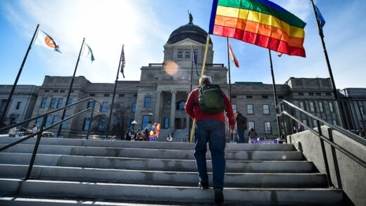 demonstrators gather on the step of the Montana State Capitol protesting anti-LGBTQ+ legislation