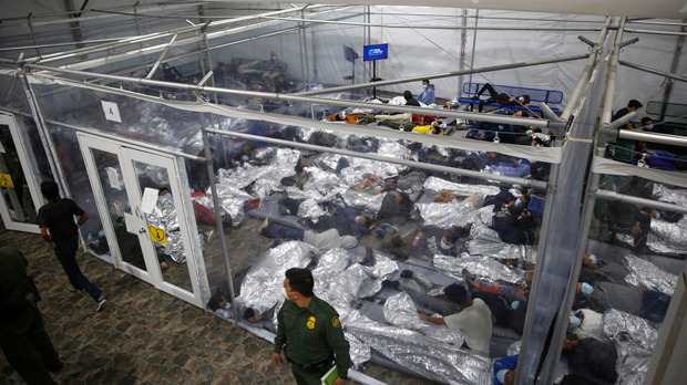 young minors lie inside a pod at the Donna Department of Homeland Security holding facility