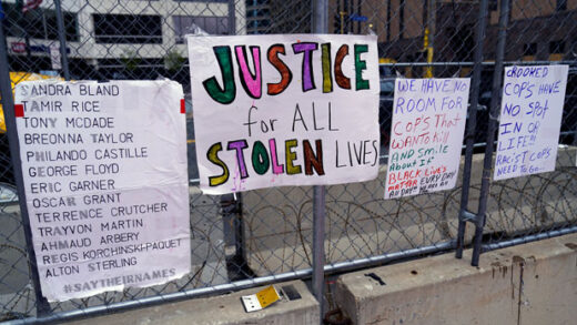 New signs are on a fence at the Hennepin County Government Center