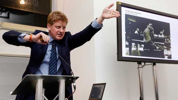 """Sotheby's auctioneer Adrian Biddell"" by Financial Times licensed under CC BY 2.0"