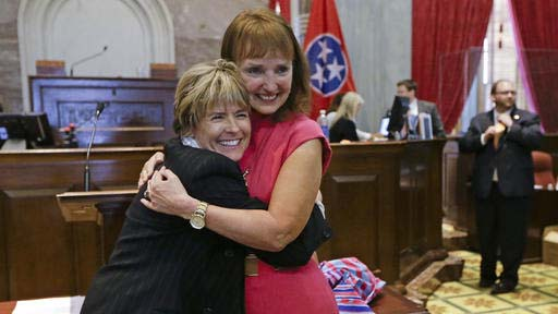 FILE - In an  April 17, 2014, file photo, Rep. Terri Lynn Weaver, left, R-Lancaster, hugs House Speaker Beth Harwell, R-Nashville, right, on the final day of the 108th General Assembly in Nashville, Tenn. Gay rights advocates are raising the alarm about a Tennessee bill sponsored by Weaver they say could make it impossible for same-sex couples to be recognized as the legal parents of children. The bill would repeal a 1977 state law that declared children born as a result of artificial insemination to be the legitimate offspring of the husband and wife. (AP Photo/Mark Humphrey, File)