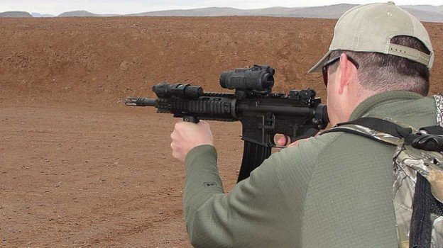 """2010 SHOT Show - Media Day at the Range - Shooting an AR-15"" by Tac6 Media licensed under CC BY 2.0"