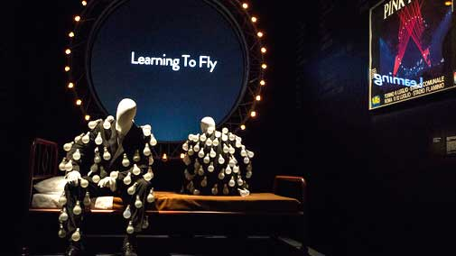 Mannequins in 'a lightbulb suit' are photographed in front of a 'Learning to Fly' display at the Pink Floyd exhibition 'Their Mortal Remains' at the V&A museum in west London, Tuesday, May 9, 2017, an immersive, experimental journey through Pink Floyd's world of over 350 objects and artefacts from the band. The exhibition marks the 50th anniversary of the band's first album, 'The Piper At The Gates Of Dawn' and officially opens to the public on 13 May (Photo by Joel Ryan/Invision/AP)