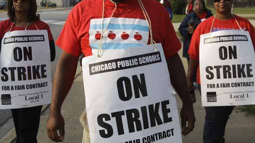 FILE - In this Sept. 17, 2016, file photo, teachers picket outside Morgan Park High School in Chicago. Teachers in the nation's third-largest public school district have overwhelmingly voted in support of a strike, though the earliest one could occur is mid-October. The Chicago Teachers Union said Monday, Sept. 26, 2016, that about 95 percent of its voting members favored strike authorization. (AP Photo/M. Spencer Green)