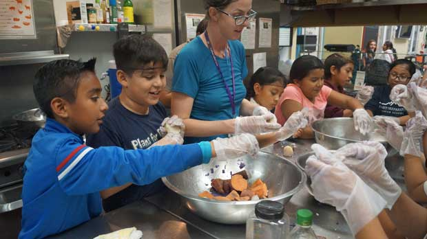 """""""Children Cooking at A Place Called Home"""" Photo courtesy of A Place Called Home"""