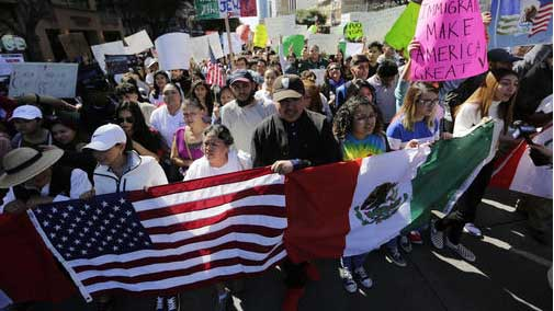 A group marches through downtown heading to the Texas Capitol during an immigration protest, Thursday, Feb. 16, 2017, in Austin, Texas. (AP Photo/Eric Gay)