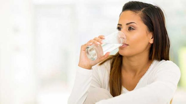 """""""woman drinking water in the morning"""" by Aqua Mechanical licensed under CC BY 2.0"""