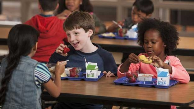 """""""Children eating lunch at school"""" by U.S. Department of Agriculture licensed under CC BY 2.0"""