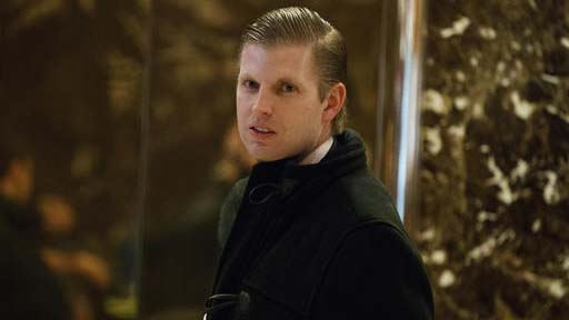 FILE - In this Dec. 15, 2016 file photo, Eric Trump, son of President-elect Donald Trump, waits for an elevator in the lobby of Trump Tower in New York. A charity operated by one of Donald Trump's sons flouts philanthropic standards by financially benefiting charities connected to the Trump family and members of the charity's board, an Associated Press investigation shows. The AP found that Eric Trump has exaggerated the size of his foundation and the donations it receives. (AP Photo/Evan Vucci, File)