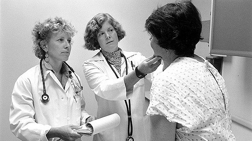 """""""Doctors with patient, 1999"""" by Seattle Municipal Archives licensed under CC BY 2.0"""