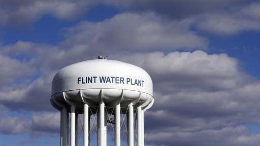 FILE - In this March 21, 2016 file photo, the Flint Water Plant water tower is seen in Flint, Mich. The inspector general for the Environmental Protection Agency says the agency had authority and sufficient information to issue an emergency order to protect residents of Flint, Michigan, from lead-contaminated water as early as June 2015, seven months before it declared an emergency.  (AP Photo/Carlos Osorio, File)