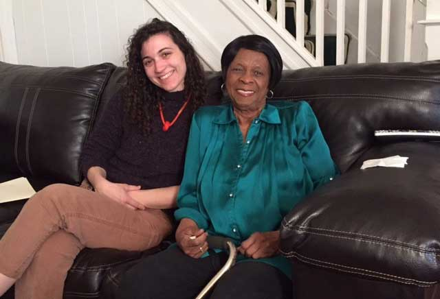 Our HUBS (Housing Upgrades to Benefit Seniors) organizer, Danielle Bouchard (left), helps connect about 100 low-income senior citizens in Baltimore to repairs and services that allow them to remain safely in their homes. Here she is shown with one of her clients, Ms. Hillery. Danielle forms bonds of trust with her clients that result in their receiving not only crucial home repairs but many government benefits to which they are entitled. Photo Courtesy of: Strong City Baltimore