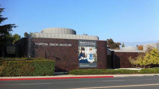 "FILE - This Jan. 21, 2015, file photo shows the exterior of the Norton Simon Museum in Pasadena, Calif. A woman who has been fighting for almost a decade over ownership of two German Renaissance masterpieces depicting ""Adam"" and ""Eve"" seized by the Nazis during World War II, has lost after a judge ruled in favor of the Southern California museum where they have hung for more than 30 years. U.S. District Court Judge John F. Walter ruled that the Norton Simon Museum is the rightful owner of the two life-size oil-on-panel paintings in a decision that the museum describes as mindful of ""the facts and law at the heart of the dispute."" (AP Photo/John Antczak, File)"