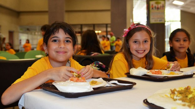 """Summer kids eat lunch"" by U.S. Department of Agriculture licensed under CC BY 2.0"