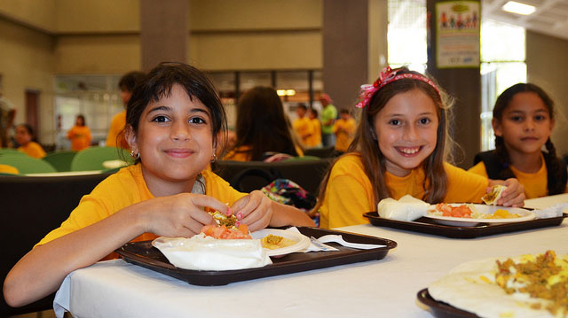 """""""Summer kids eat lunch"""" by U.S. Department of Agriculture licensed under CC BY 2.0"""