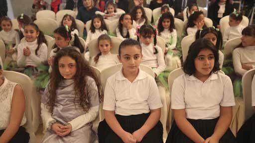 Elementary school students wait to perform at a press conference for the release of the 2016 State of the World Population report by the United Nations Population Fund on Thursday, Dec. 1, 2016 in Amman, Jordan. (Sam McNeil/AP Photo)