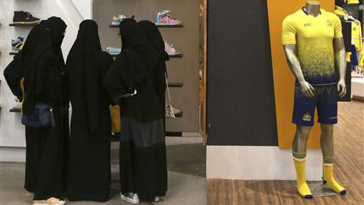FILE - In this Friday, Dec. 11, 2015 photo, Saudi women shop at a mall in Riyadh, Saudi Arabia. A new study by Human Rights Watch says Saudi Arabia's male guardianship system is the most significant impediment to realizing women's rights in the kingdom. (AP Photo/Khalid Mohammed, File)