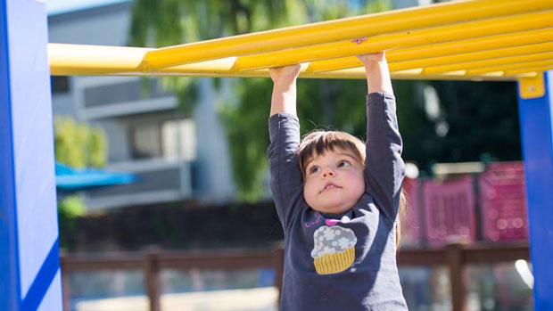 """""""Kid playing in the monkey bars"""" Photo courtesy of Holy Family Day Home"""