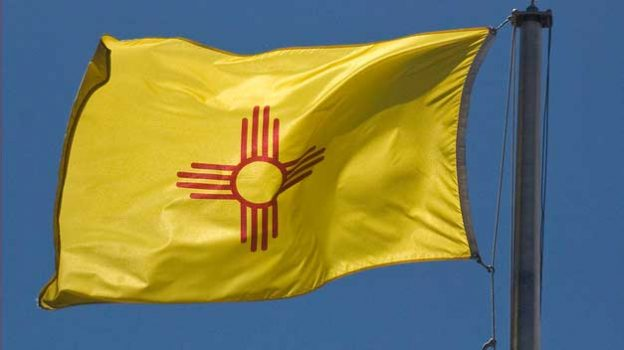 """New Mexico State Flag -- The Capitol Santa Fe (NM) 2013"" by Ron Cogswell licensed under CC BY 2.0"
