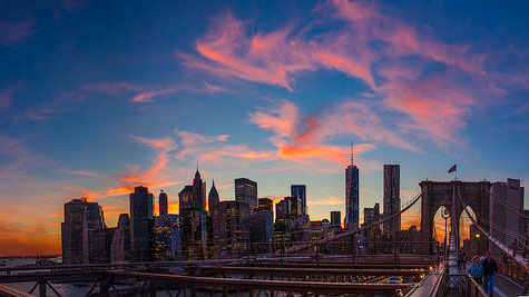 """New York City Sunset Panoramic 2014"" by Anthony Quintano licensed under CC BY 2.0"