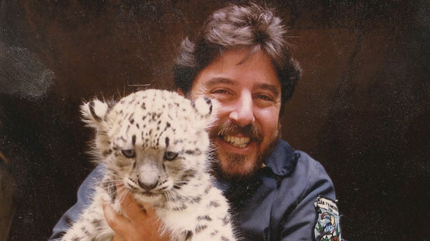 """Norman Gershenz Director, CEO, and, Co-Founder of SaveNature.Org with a Snow Leopard Cub"" Photo courtesy of SaveNature.Org"