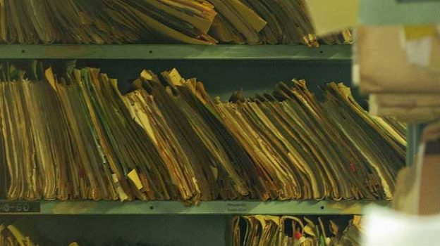 """""""Paper files of medical records"""" by Newtown grafitti licensed under CC BY 2.0"""