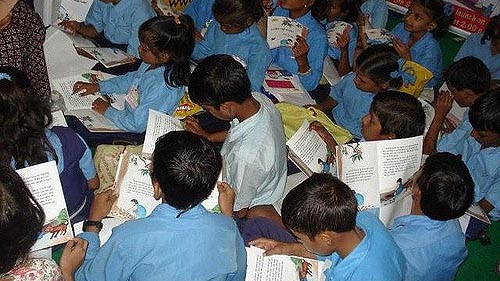 """Children Reading Books"" by Pratham Books licensed under CC BY 2.0"