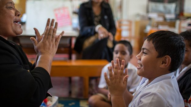 """""""Lesieli Latu teaches students with..."""" by Department of Foreign Affairs licensed under CC BY 2.0"""