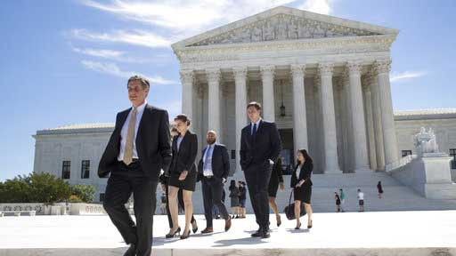 People leave the Supreme Court in Washington, Monday, June 26, 2017, as justices issued their final rulings for the term. The high court is letting a limited version of the Trump administration ban on travel from six mostly Muslim countries to take effect, a victory for President Donald Trump in the biggest legal controversy of his young presidency. (AP Photo/J. Scott Applewhite)